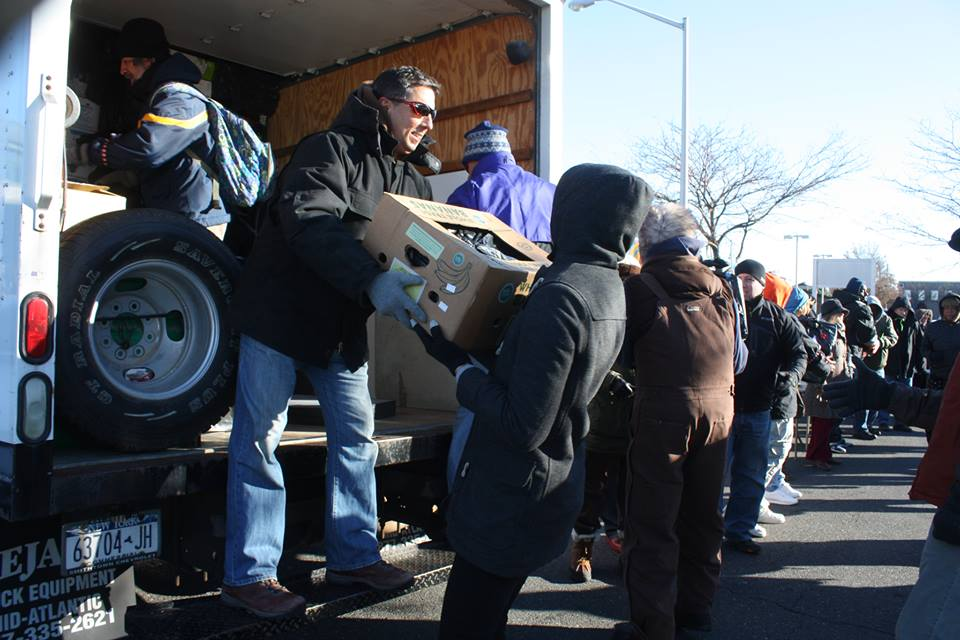 Unloading trucks of donations at the Community Solidarity Hempstead Food Share