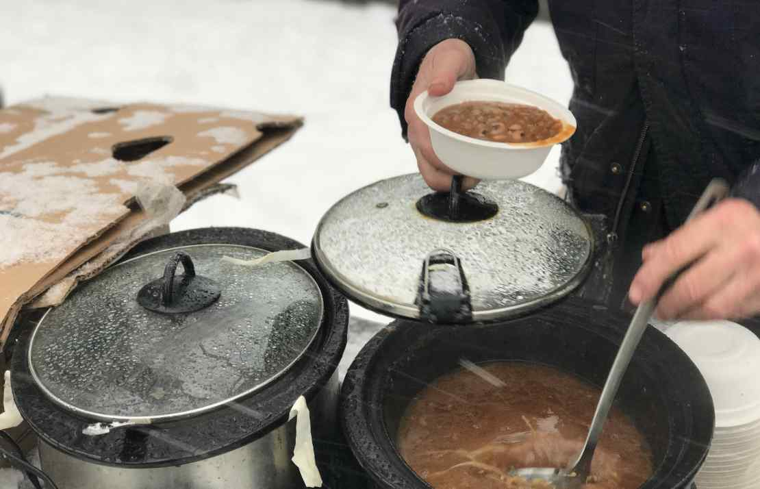 Gordon Fitch serving soup during a blizzard at the Community Solidarity Bedstuy Brooklyn Food Share