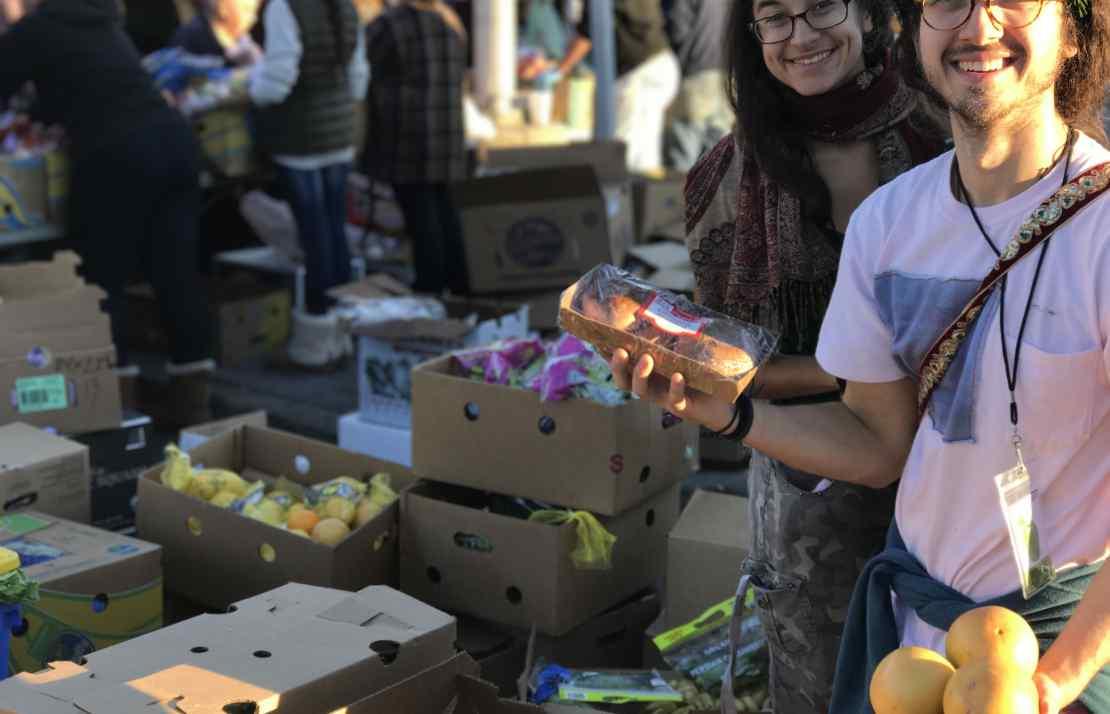 Volunteers Andrew & Lauren, helping at the Community Solidarity Hempstead Food Share